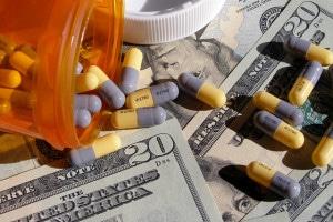 pill bottle, pills, and cash