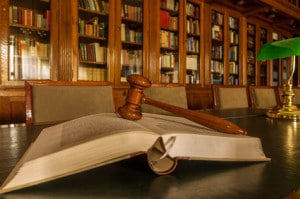 Image of a book and gavel representing pre-trial negotiations