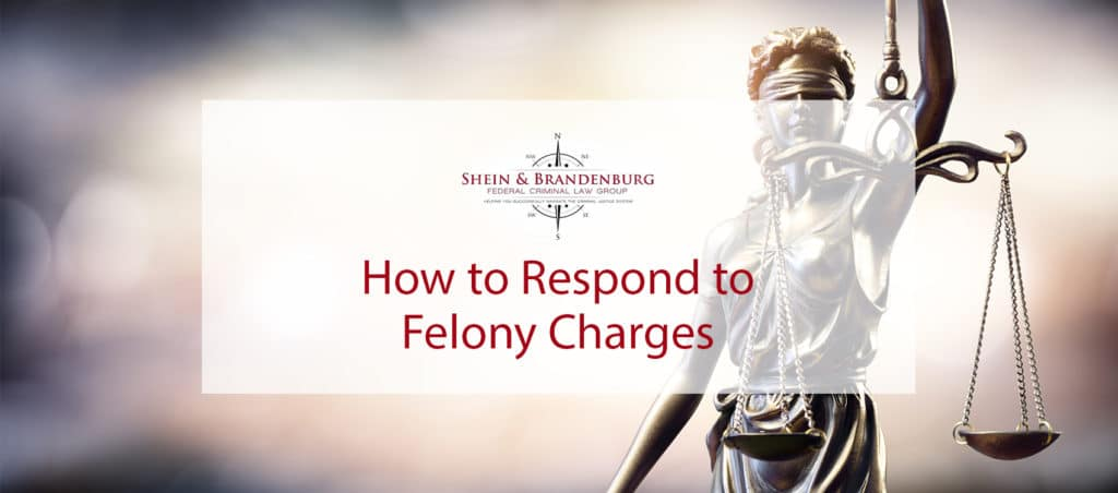 featured image for a blog about felony charges and how to respond to them. Image features a statue of lady justice holding a scale.