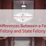 Featured image for a blog about federal and state felony charges. Graphic shows the inside of an empty courtroom.