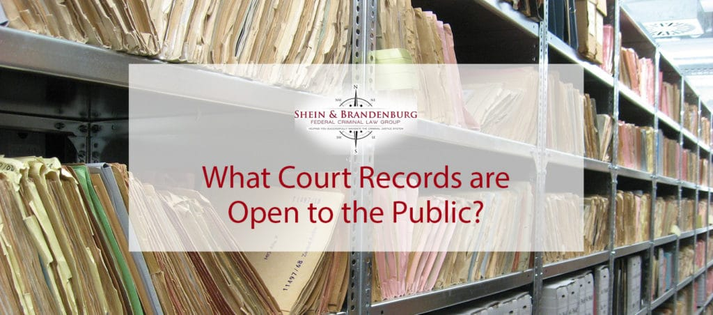 Featured image for a blog that discusses what court records are open to the public. The image is a giant room of files on shelves.
