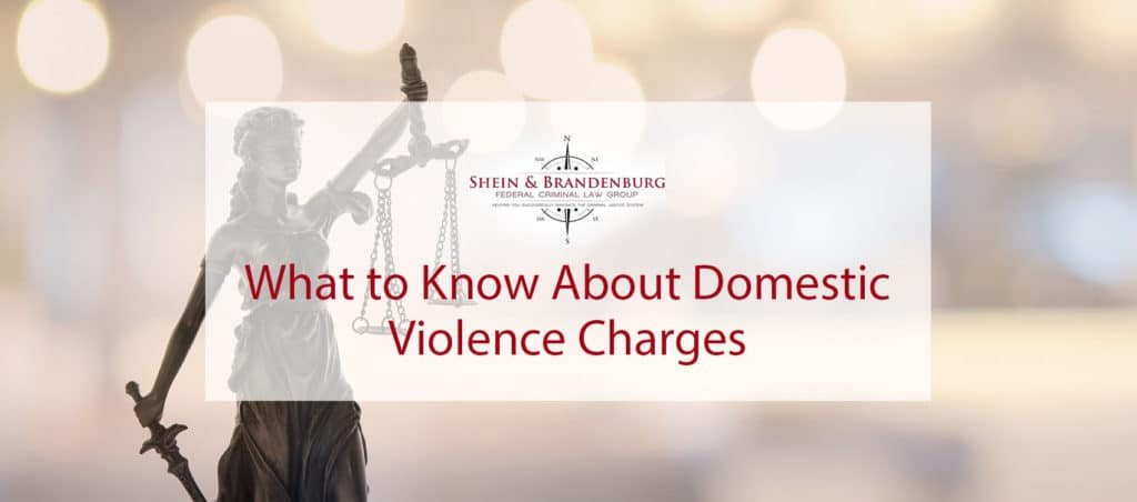 Featured image for a blog about domestic violence charges. The blog features a statue symbolizing law and justice.
